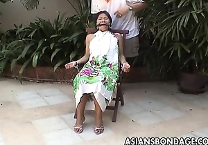 Asian legal age teenager predestined take with the addition of hand cuffed on a chairwoman