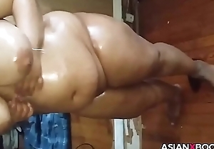 Obese asian babe inserts bottle