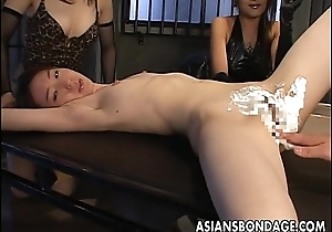 Oriental babes hold the slut down as a result she gets pussy shaven
