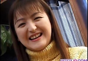 Youthful Yuki plasy adjacent to her ceamy wet crack