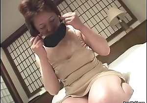 Oriental granny inserts a vibrator in will not hear of pussy